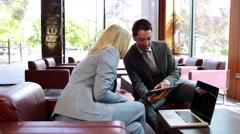 Business people using digital tablet in meeting - stock footage