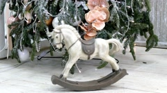 Vintage rocking horse on christmas tree background Stock Footage
