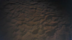 Night scene of footprints in the sand Stock Footage