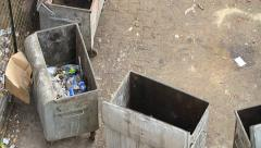 Garbage containers. Old metal garbage dumpsters on the street - stock footage