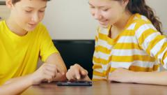Kids together playing a game with a cell phone Stock Footage