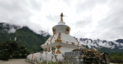 4k tibet buddhist white stupa,time lapse of clouds cover mountain. Stock Footage