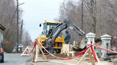 Excavator Works at the City Street Stock Footage