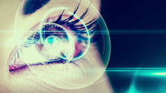 Eye scanning a futuristic interface Stock Footage