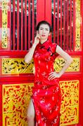 chinese woman in red dress traditional, cheongsam. - stock photo