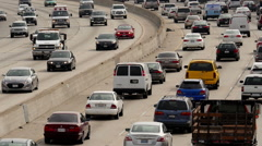 Zoom Out / View of Traffic on Busy Freeway in Downtown Los Angeles California Stock Footage