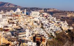 view of fira in the evening on santorini. - stock photo