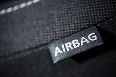 Stock Photo of side car airbag tag. modern car safety feature. transportation technologies.