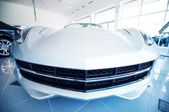 Modern super car in dealer showroom. car sales industry Stock Photos