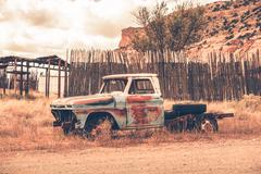 antique clunker pickup truck abandoned somewhere in arizona. - stock photo