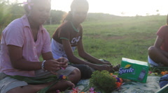 Girls Making a Lei by Hand on the island of Yap Stock Footage