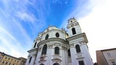 Timelapse of clouds moving over the Collegiate church in Salzburg Stock Footage