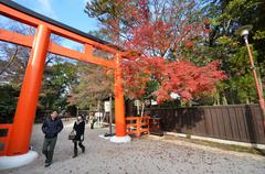 Tourists visit shimogamo shrine orange archway in kyoto, japan Stock Photos