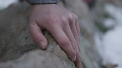 A young woman grips the rock on her climb Stock Footage