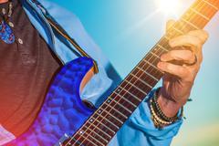 Rock guitar player. men playing electric guitar closeup photo. Stock Photos