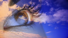 Eye blinking with blue sky Stock Footage