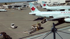 Air canada airplanes sit parked at terminal of airport Stock Footage