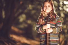 young caucasian girl with classic acoustic guitar - stock photo