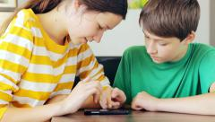 Kids together playing a game, cell phone Stock Footage