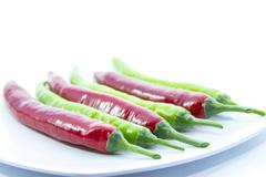 Contrast green switched red chili pepper Stock Photos