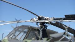 Helicopter Blades seen through Barbed Wire Fence - stock footage