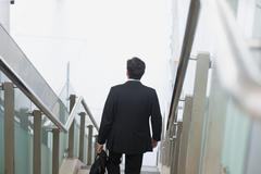 indian businessman descending steps - stock photo