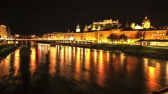 Timelapse of River Salzach flowing through Salzburg at night - stock footage
