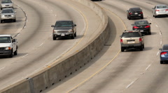 Zoom Out / Time Lapse View of Traffic on Busy Freeway in Downtown Los Angeles Stock Footage