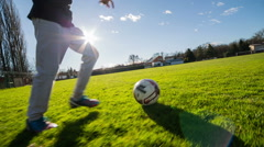 Person dribbling with soccer ball side low angle shot Stock Footage