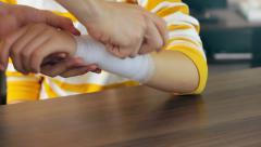 Man bandaging the arm, first aid Stock Footage