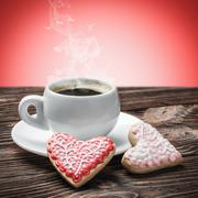 hot cup of coffee and homemade cookies on the table - stock photo
