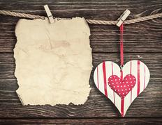 Stock Photo of old paper with heart and place for congratulations valentine or mother's day