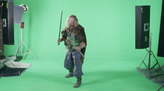 A Medieval Warrior Readies Himself For Battle In Front Of A Green Screen. Stock Footage