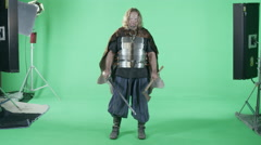 A Medieval Viking Warrior Prepares For Battle (Green Screen). - stock footage