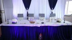 Wedding main table set awaiting guests - stock footage