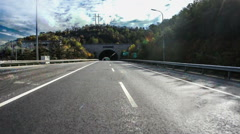Driving fast on the highway including tunnel, Beijing, China - stock footage