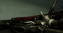 Pan across military weapons stacked on top of each other Stock Footage