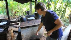 Woman Shows Kitchen on Micronesian Island of Yap Stock Footage