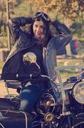 woman at motorbike - stock photo