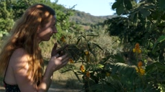 Girl smelling wild flowers Stock Footage