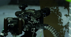 Mini gun and target full of holes at firing range Stock Footage