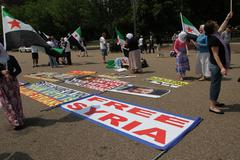 protest the syrian diaspora against russia's support of assad's regime - stock photo