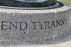 Stock Photo of end tyranny - the inscription on the historical monomate in washington, usa