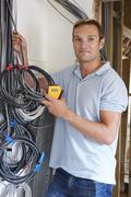 Electrician fitting wiring on construction site Stock Photos