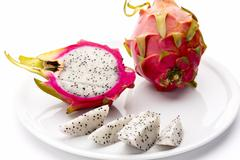 Pitaya fruit wedges, a halved and a whole fruit Stock Photos