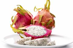 closeup on fruit flesh of the dragonfruit on a plate - stock photo