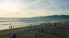 Beach Shore Sand Pacific Ocean People Panning Mountain Summer Sunset Vacation Stock Footage