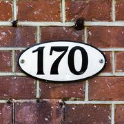 Enameled house number one hundred and seventy on an oval plate - 170 Stock Photos
