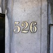 Gold colored house number five hundred and twenty six - 526 Stock Photos