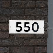 house number five hundred and fifty. black numerals on a white background -550 - stock photo